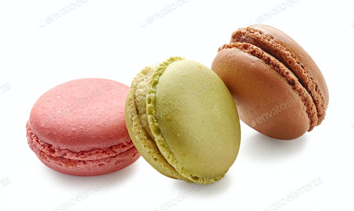 various macaroons on white background