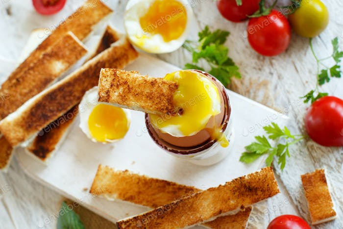 Soft-boiled egg with toasts