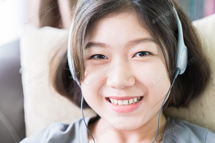 Young woman listening music from mobile phone-16
