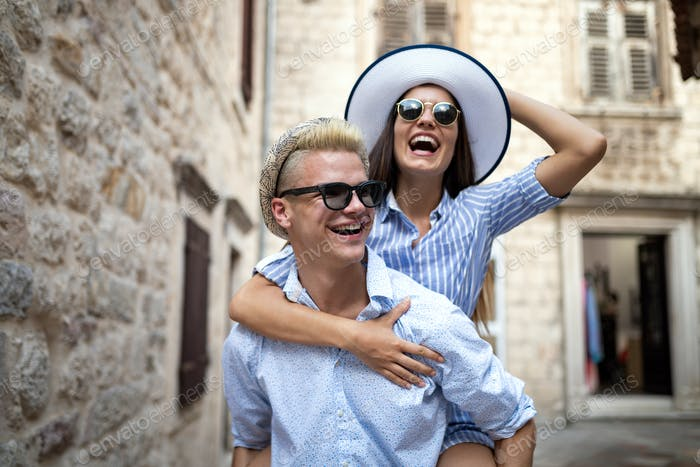 Happy loving couple. Happy young man piggybacking his girlfriend