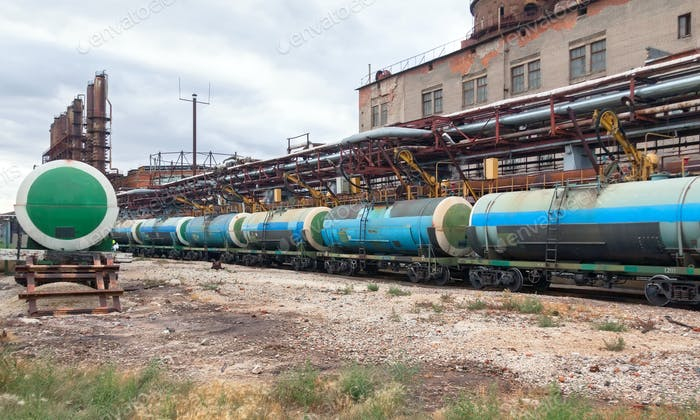 Filling chemicals railroad cars tanks on the plant