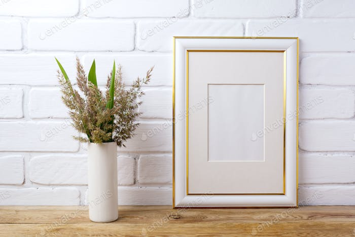 Gold decorated frame mockup with  grass and green leaves in cyli