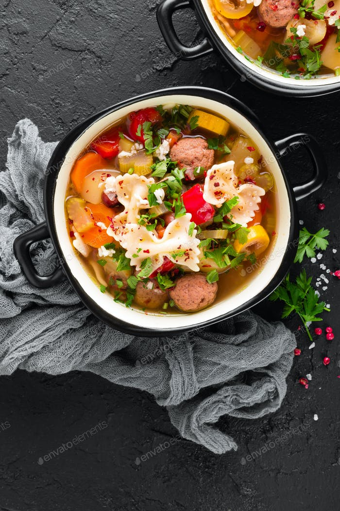 Italian minestrone soup with beef meatballs, vegetables and pasta