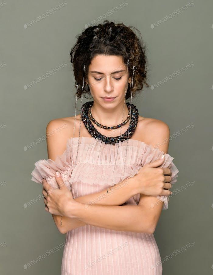 Elegant woman in off the shoulder pink top