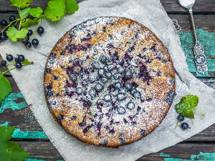 Black currant cake over the old painted wooden surface