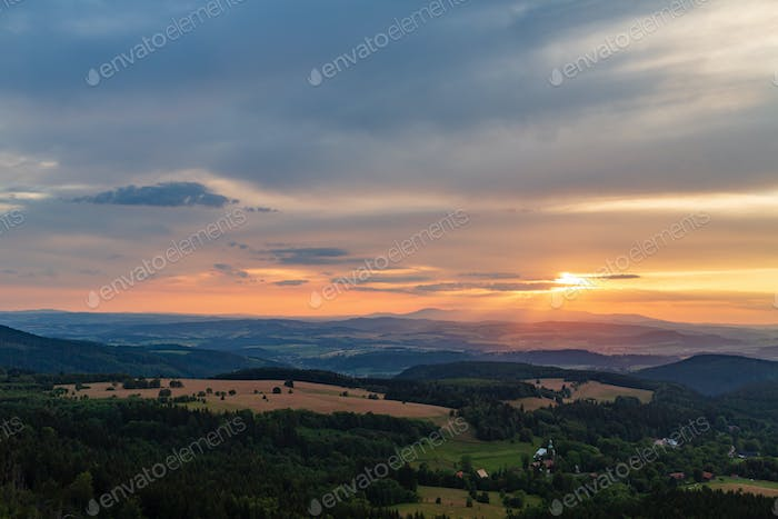Summer sunset landscape green forest and mountains