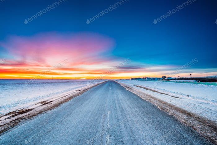 Asphalt Country Open Road Through Winter Snowy Fields And Meadow