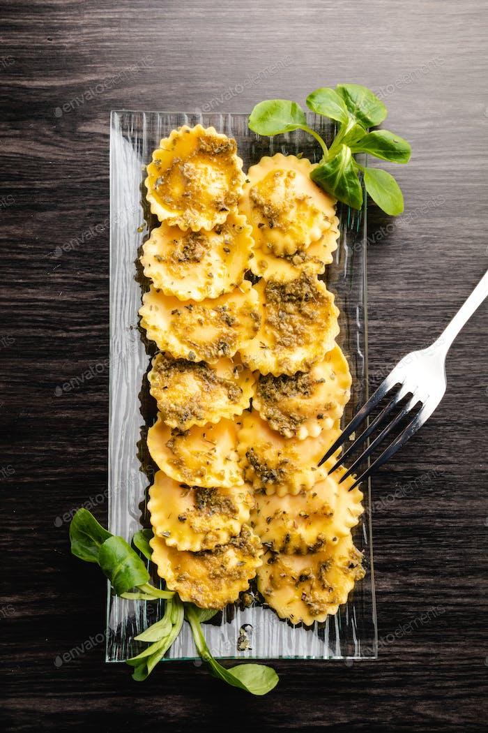Italian stuffed pasta ravioli with pesto sauce
