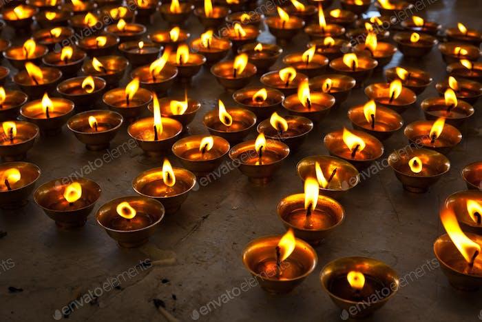 Burning candles in Buddhist temple. McLeod Ganj, Himachal Pradesh