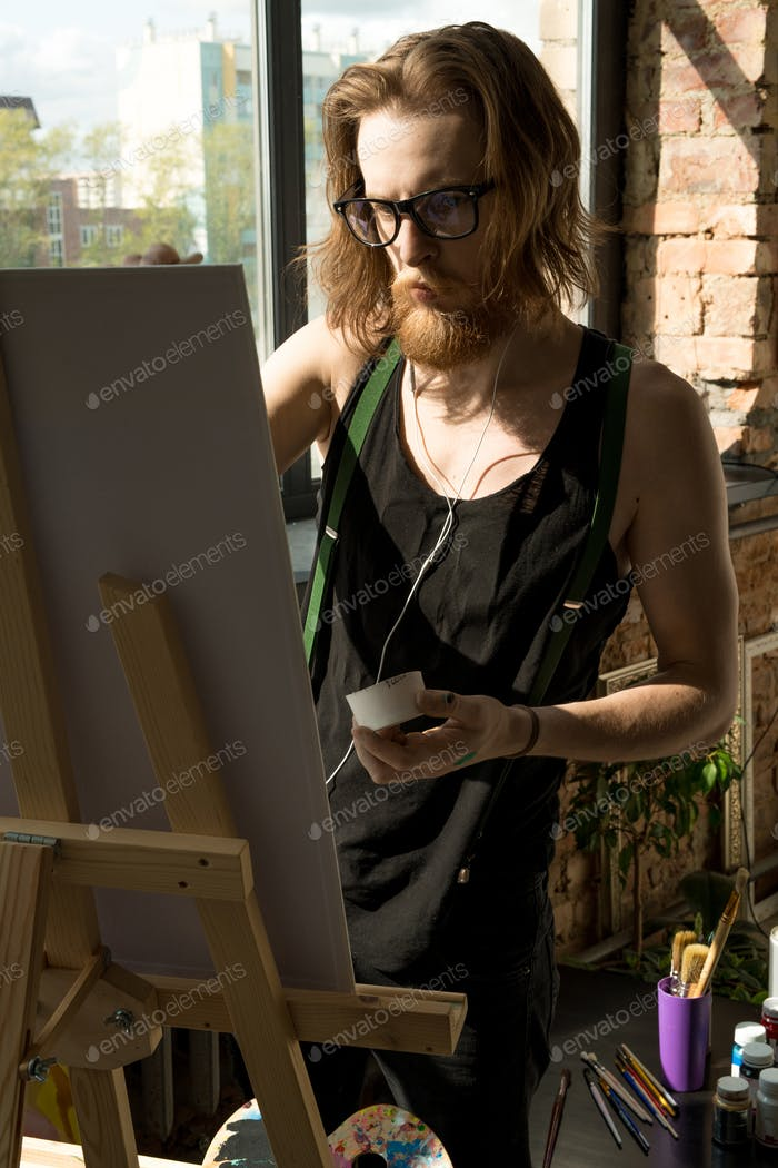 Modern Artist Painting by Easel in Sunlight