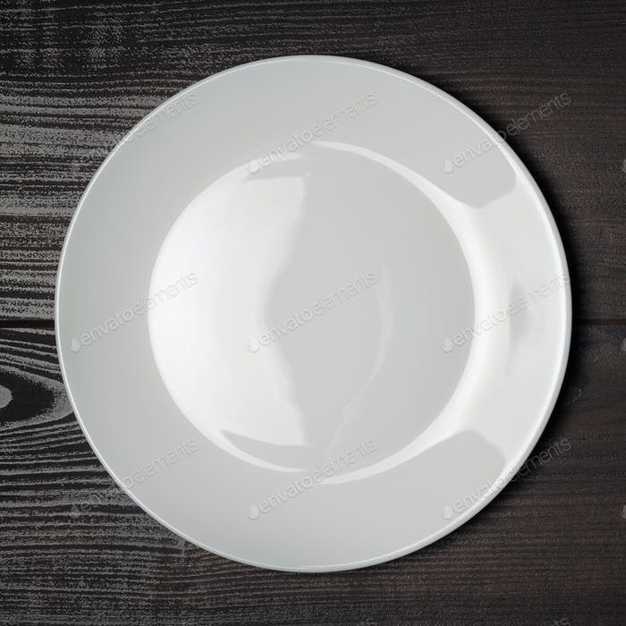 White Plate On The Wooden Brown Table