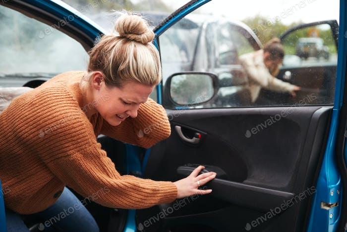 Female Motorist In Crash For Crash Insurance Fraud Getting Out Of Car