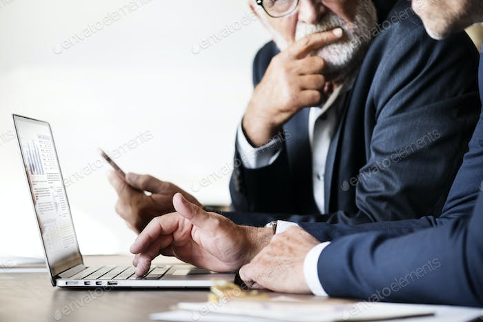 Businessmen using computer laptop