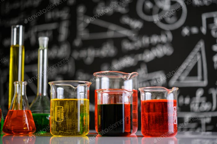 Laboratory glassware with liquids of different color.