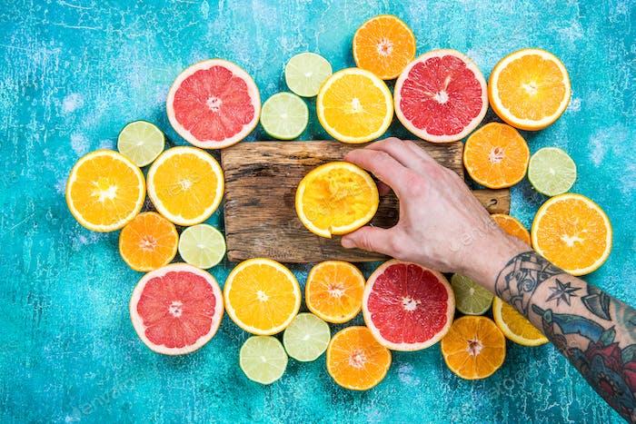 Hand squeezing orange for juice
