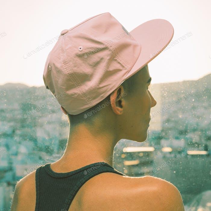Girl in a stylish cap. Urban Street vibes