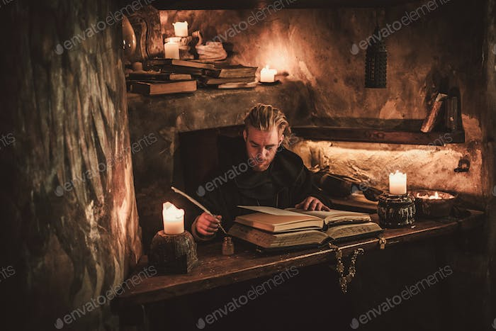 Monk chronicler writes an ancient manuscript