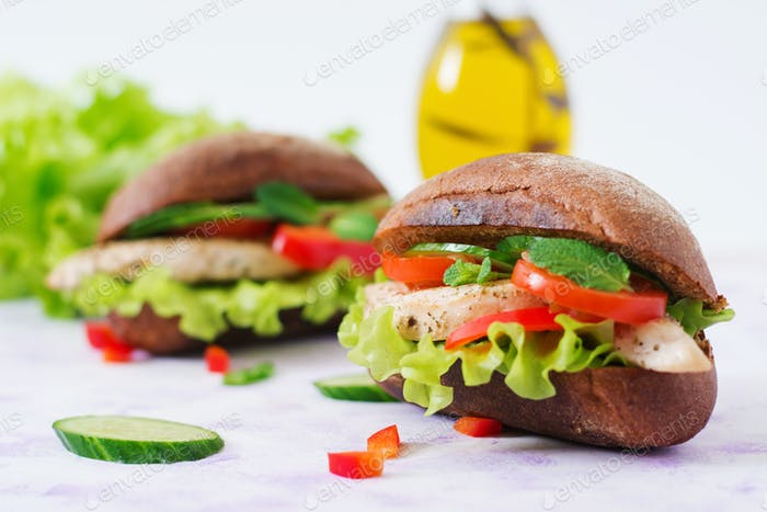 Two delicious and healthy sandwich hot dog with chicken and vegetables.