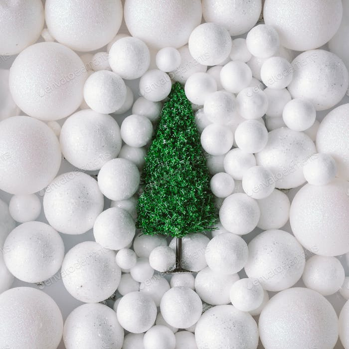 Christmas tree in white snow balls decoration. Flat lay. Minimal New Year concept.