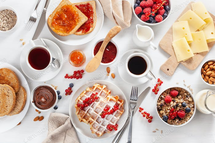 breakfast with granola berry nuts, waffle, toast,  jam, chocolat
