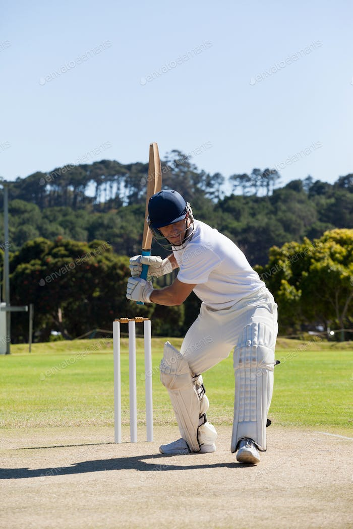 Cricket player playing on field against clear sky