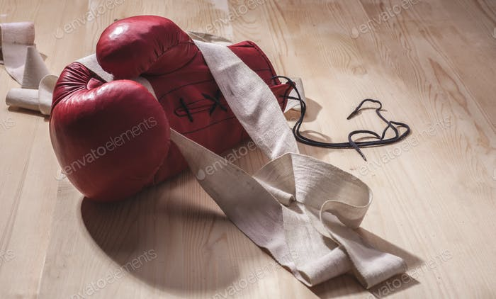 red mitt with handwrap on wooden floor