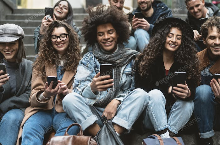 Young people using mobile smartphone outdoor