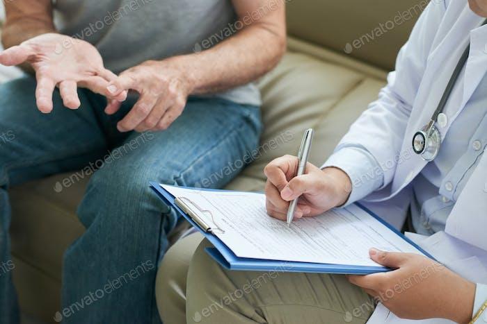 Crop doctor writing patient complaints