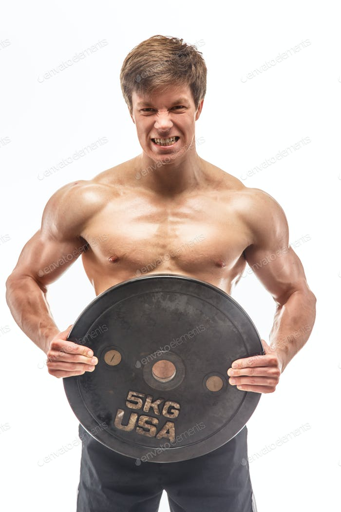 Awesome young bodybuilder holding weights