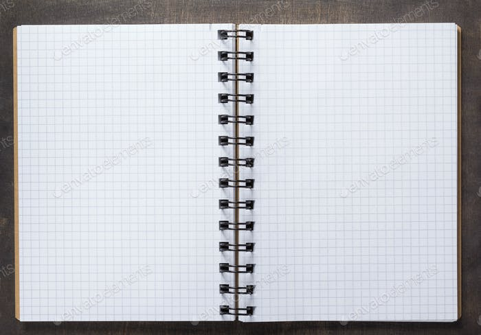 notebook at wooden background surface table