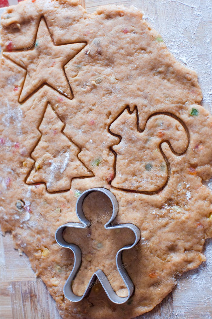 Cutting the gingerbread cookie dough for Christmas and New Year