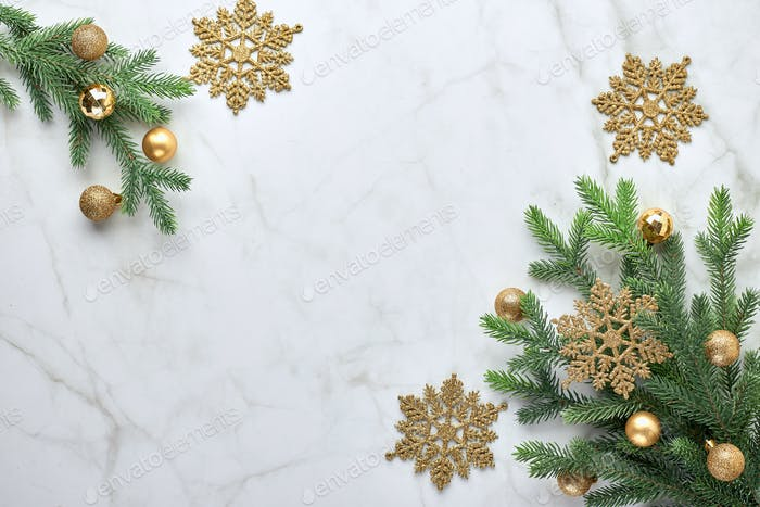 Christmas background with tree and gold decorative ornaments and balls. Flat lay, top view