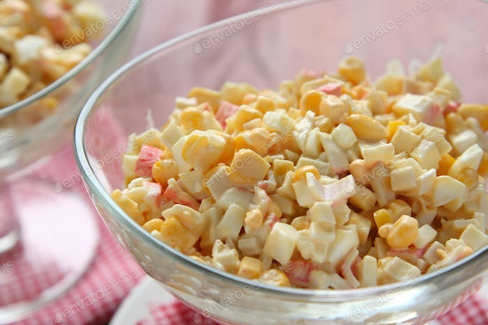 Crab salad with eggs, sweet corn and mayonnaise