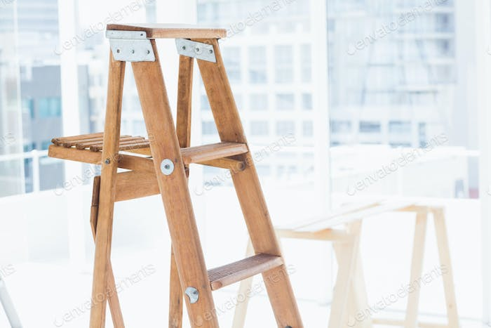 Thumbnail for Wooden step ladder in bright office