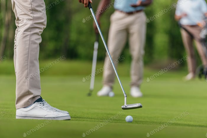 cropped shot of golfer getting ready to shot on the fairway