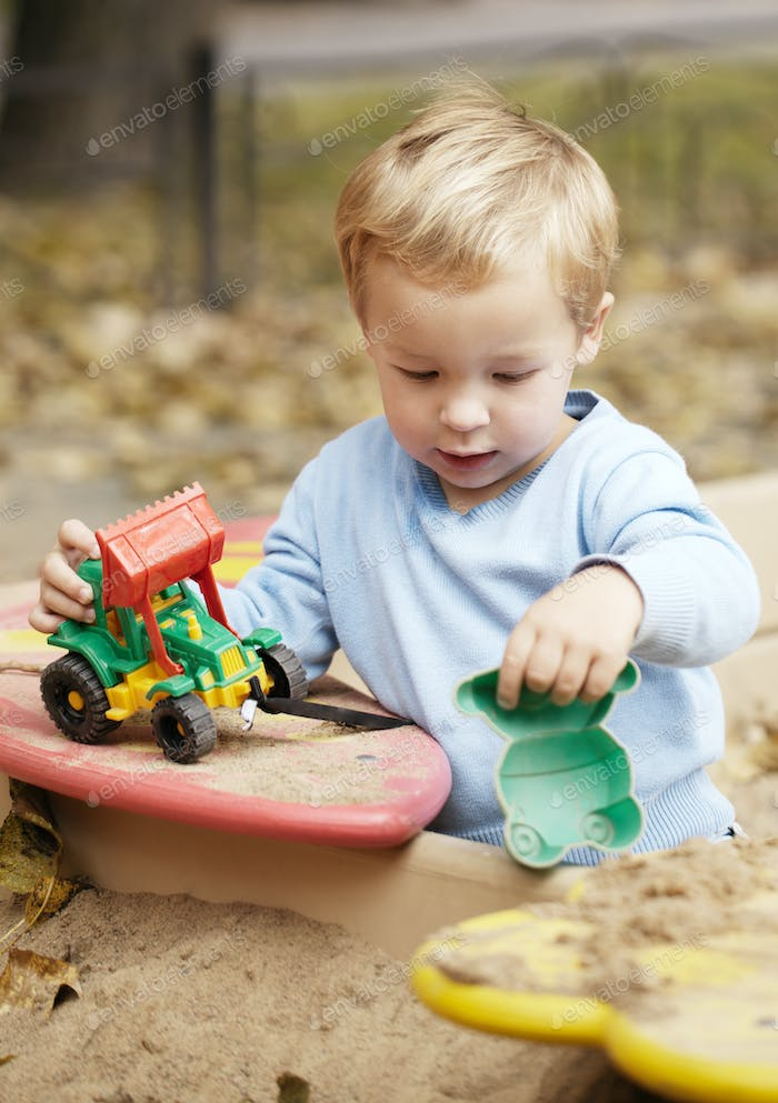 Boy playing with toy outdoor