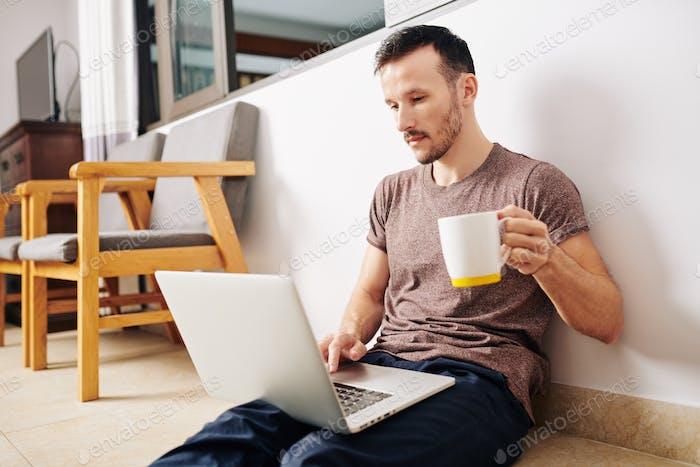 Man watching educational video