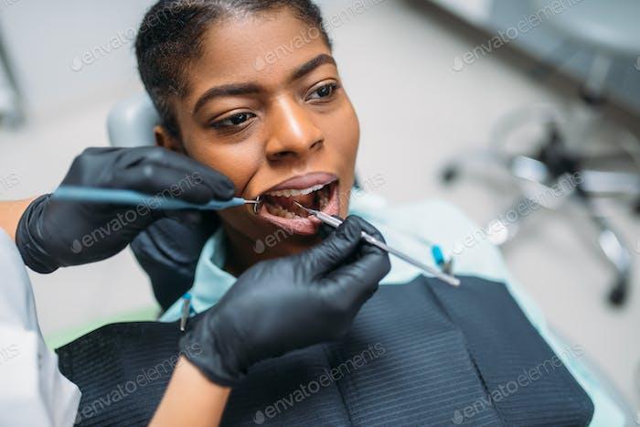 Dentist examines the teeth, dental clinic