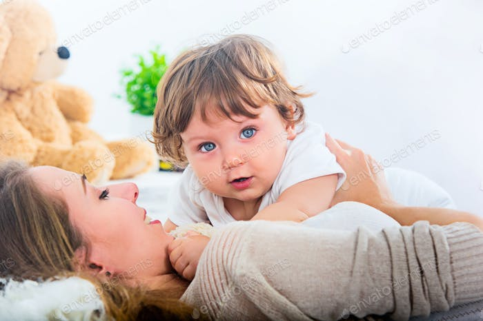 Happy woman with son - baby boy