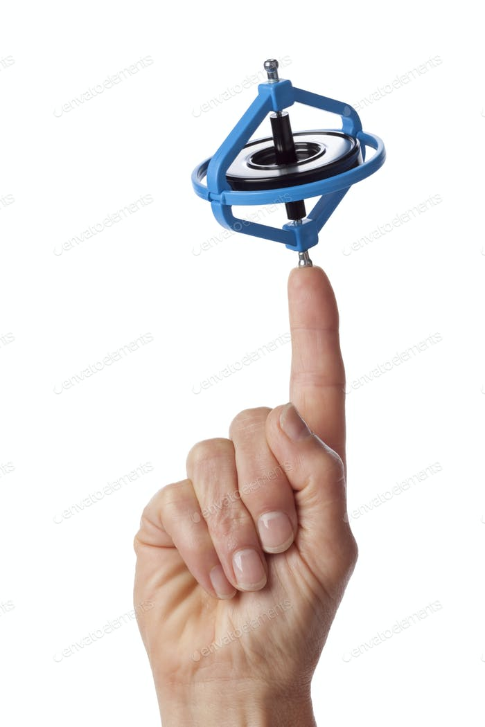 Finger with a spinning gyroscope on white background