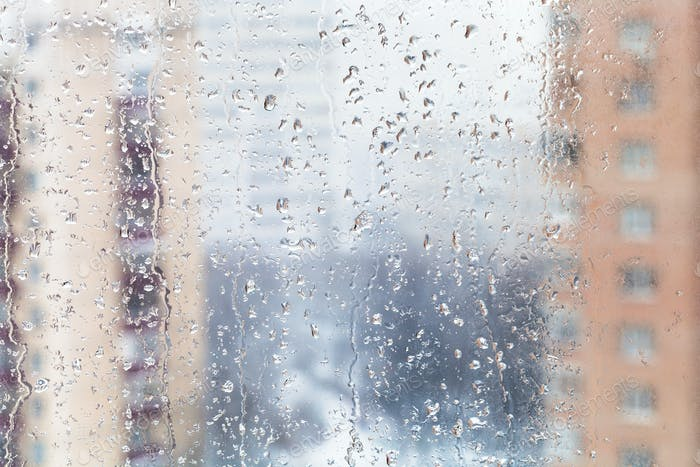 rain drops on home window glass in winter