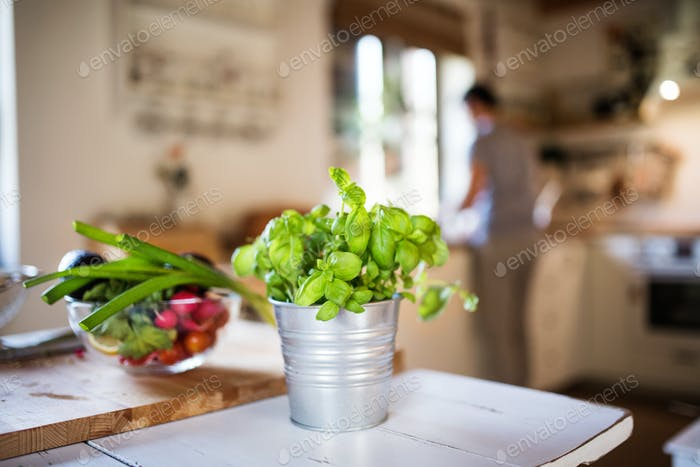 Fresh vegetables and herbs on the table.