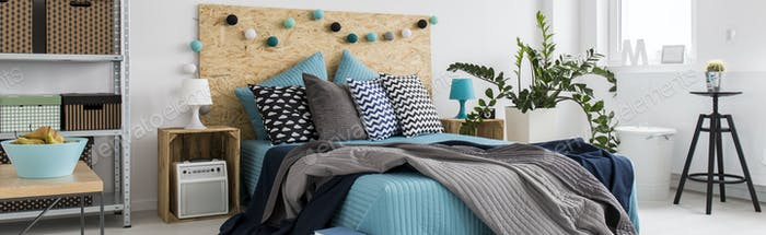 Bedroom decorated with blue and gray