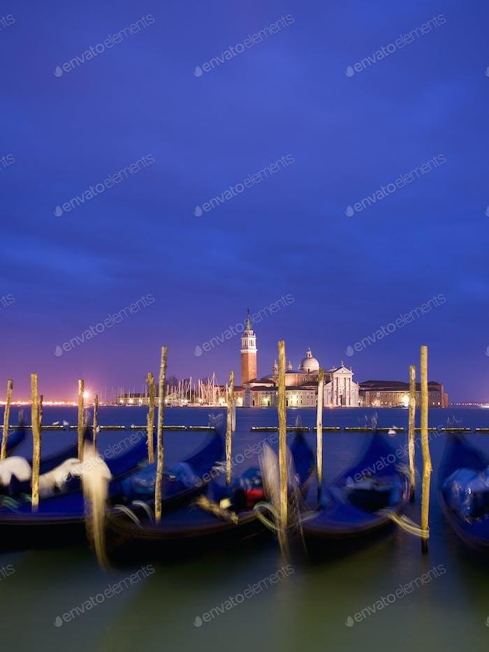 A view across moored gondolas to the island and church of San Giorgio Maggiore.