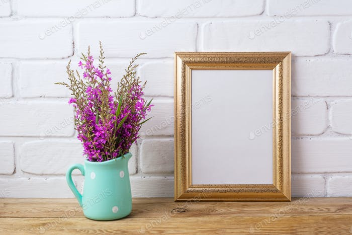 Golden  frame mockup with maroon purple flowers in mint pitcher