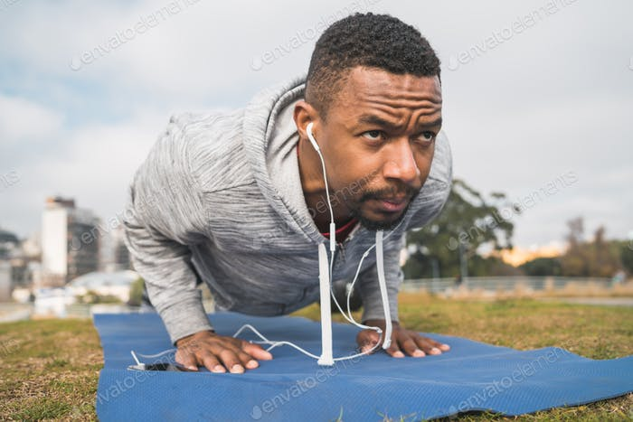 Athletic man doing push ups.