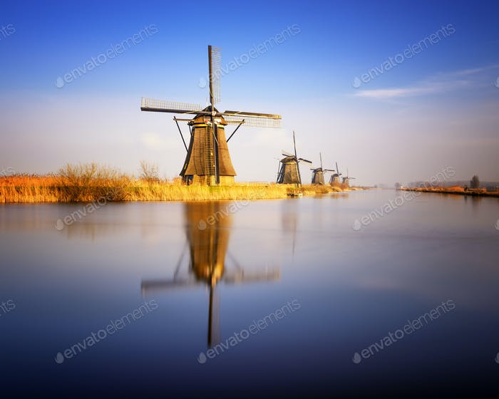 Sunset view at typical windmill at Kinderdijk, Holland.