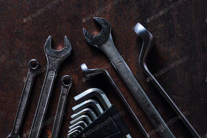 The metallic tool on the rusty metal floor