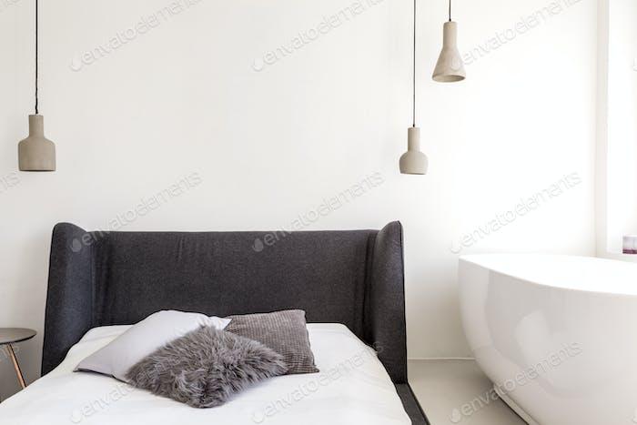 Bath in minimalist bedroom