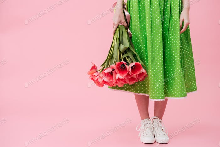 Cropped image  woman holding bouquet of flowers